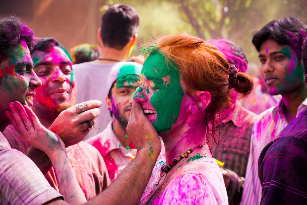 Photo of People Painting Faces During the Holi Festival